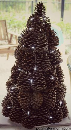 DIY Pinecone Tree Centrepiece - easy and frugal to make! Get the kids involved by helping to collect and sort the pinecones!