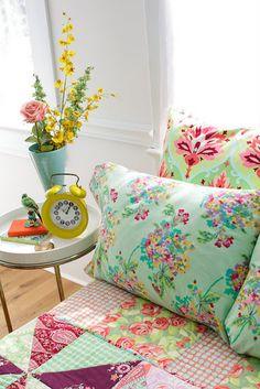 bright floral bedding & fabrics.