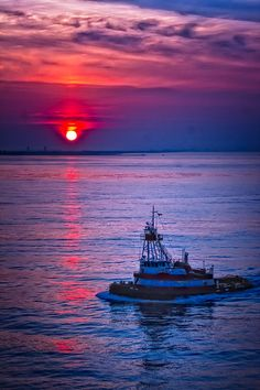At work early, tugboat on New York Harbour New York