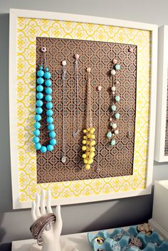 IHeart Organizing: A Simple DIY Jewelry Display (NOTE: cork behind the decorative sheet metal)