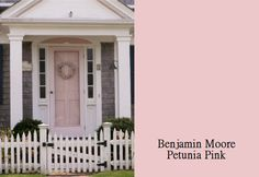what a cute little cottage with Ben Moore Petunia Pink paint on the front door