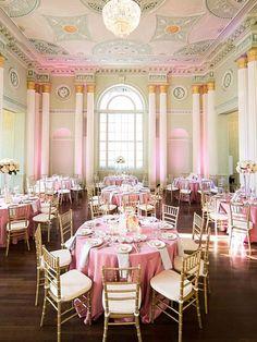 Classic ballroom reception with soft pink uplighting