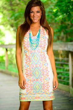 PERFECTION! This dress it to die for! We love the white material and how fabulous it is! The colorful embroidery is what makes the dress though! Such a sweet and sassy look that we're sure we'll look great on everyone this summer!