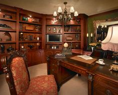 Wood-centric home office design with built-in wood shelving, contemporary chandelier and wood office furnitre