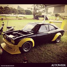 """""""Simple outside but serious inside. 1972 Mazda RX 2 13 BPP. Frank Radisch."""" Instagram photo from the Leadfoot Festival in Hahei, New Zealand. Shot for Autoweek by Melissa Eickhoff, producer of a Velocity TV program about the festival. For more on the event, go to leadfootfestival.com."""