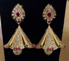 CZ and ruby emerald stone jhumkas with pearl drop Size : inches long Code : ERJ 412 Price : Whats app to 09581193795 for order processing Gold Earrings, Gold Necklace, Drop Earrings, India Jewelry, Emerald Stone, Diamond Jewellery, Gold Material, Necklace Designs, Jewelry Collection