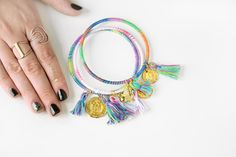 DIY Embroidery Thread Wrapped Bangles Tutorial from Quiet Lion Creations.I've posted so many DIY Embroidery Thread Wrapped Bangles, but if your learning style leans more toward videos, this is a good one from Quiet Lion Creations. My learning style. Diy Embroidery Thread, Embroidery Bracelets, Embroidery Patterns, Diy Francais, Hippie Bracelets, Tassel Bracelet, Stone Bracelet, Tassel Earrings, Hippie Jewelry