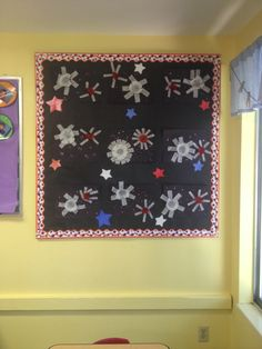 My preschool bulletin board for July!  Fireworks Black paper Glitter  Cupcake filters  Candy filters  Star tissue paper