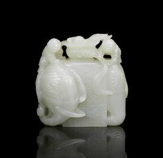 A fine very pale green jade carving of an elephant and boys, Qianlong