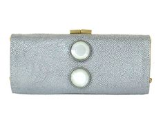 Jimmy Choos Antique Silver Stingray Clutch is true exotic elegance! In pristine condition with its dustbag this fabulous case has a hinged frame and opens with a brushed gold kiss lock to gold satin lining inside. Iridescent white details on the front  - goalsBox™