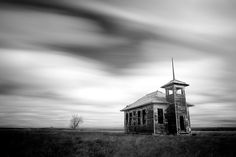 An old one-room schoolhouse decaying on the lonesome prairie outside of Havre, Montana.    Montana, it seems, has an abundance of abandoned buildings. Most are remnants of a a more propserous time during the mining boom at the turn of the century.