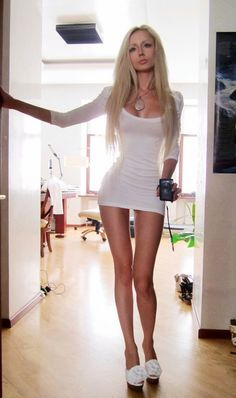 Nice girl in very tight white dress