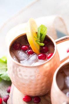 Cranberry Orange Moscow Mule is served in a copper mug to keep it nice and cold. A refreshing holiday drink.