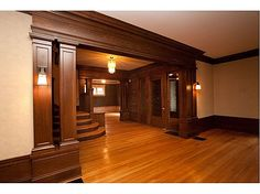 craftsman moulding - check, beautiful stairs- check, gorgeous door - check, fab fixtures - check