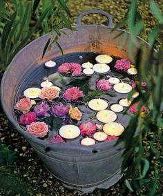 Droomtuin: zinken teil, vullen met water, bloemen erin en drijfkaarsen