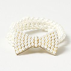 Triple Strand Pearl Bracelet with Bow  $10.50 [clairs store]