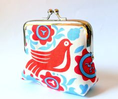 Birds coin purse in medium with red birds and blue on a white background. $26.00, via Etsy.