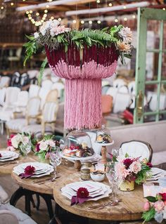 yarn chandelier and wooden table