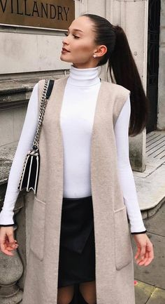 fall outfit inspiration / nude vest + white top + bag + skirt