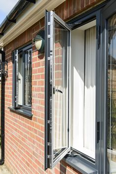 Open casement window finished in Anthracite Grey on the outside and white on the inside
