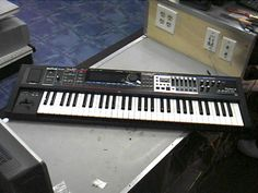 Roland Juno Gi.  Has that Billy Joel 80s piano sound.  Seems to be $1000 on average on Ebay.  Possibly less if you're lucky and an auction sniper?
