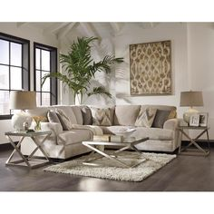 This oversized chaise sectional features a contemporary design with a faux leather base and microfiber-covered cushions. Patterned loose back pillows and 2 accent pillows are coordinated for a unique look. Ashley Ameer Cream Chenille Sectional | Weekends Only Furniture and Mattress
