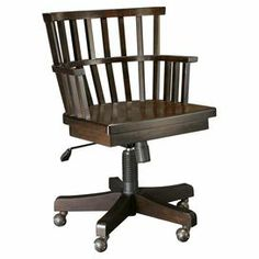 """Inspired by early 20th-century industrial designs, this dark wood desk chair showcases castered feet and a distressed finish.  Product: ChairConstruction Material: Metal and birch veneersColor: Distressed brown and grayFeatures:  Five castersHeavily distressed finishAdjustable height Dimensions: 35"""" H x 23"""" W x 23"""" D"""