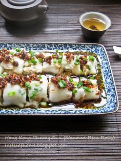 Cheong Fun!   I love this recipe at Dim Sum time!   Plain, filled with Char Siew (BBQ) Pork or steam shrimp...any of these ways you prepare it, it puts a big smile on my face.  :)