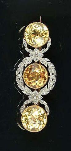An Edwardian yellow sapphire and diamond bar brooch, circa 1905.