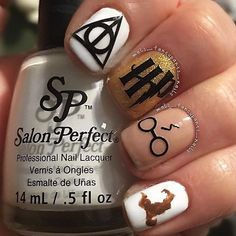 Where are my fellow Potter heads? ⚡️ @mels_fancypants_nails used Harry Poyter vinyls and Salon Perfect polish in 'Sugar Cube' as a base to create this adorable nail design. Available exclusively at select @walmart stores nationwide!