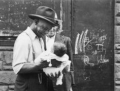 A touching moment captured by Helen Levitt, street photographer, New York, circa early 1940's....