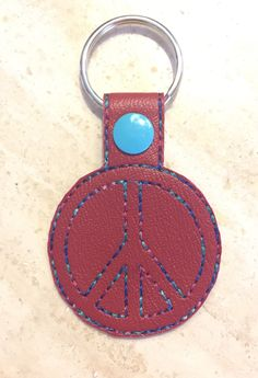 A personal favorite from my Etsy shop https://www.etsy.com/listing/496610522/peace-sign-key-chain-zipper-pull-marine
