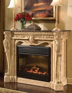 "VERSAILLES ELECTRIC FIREPLACE - Cozy evenings at home...both elegant and inviting, this cast stone electric fireplace features historic carvings and black fossil tone mantle top. 30"" firebox, on/off switch and thermostat."