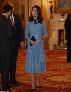 Radiant: Kate paired the powder blue dress with heeled shoes and a small black clutch bag...