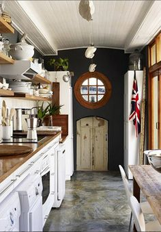 """THe British """"look"""" always feels elegant and stately to me -- even when its worn, simple, and casual like this small kitchen."""