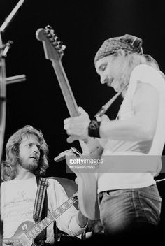 Guitarists Don Felder (left) and Joe Walsh performing with American rock group, The Eagles, at Wembley Empire Pool (now Wembley Arena), London, during their Hotel California tour, 27th April 1977.