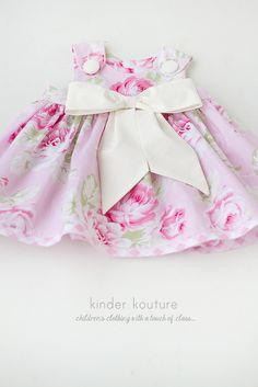 This gorgeous handmade baby dress is perfect for any special occasion. The pink rose colored