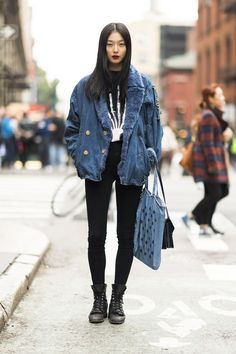 Shop this look for $144:  http://lookastic.com/women/looks/denim-jacket-and-crew-neck-t-shirt-and-skinny-jeans-and-boots-and-tote-bag-and-crossbody-bag/2459  — Blue Denim Jacket  — Black and White Print Crew-neck T-shirt  — Black Skinny Jeans  — Black Leather Boots  — Blue Canvas Tote Bag  — Black Leather Crossbody Bag