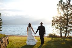 Edgewood Tahoe wedding by Doug Miranda Photography of a couple walking off into the sunset with Lake Tahoe in the background.