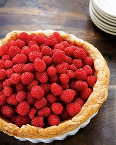 Raspberry Custard Tart: Creme fraiche gives a deliciously tangy edge to the custard in this puff pastry tart. No need to fuss when arranging the raspberries on top; they should look as though they've simply tumbled onto the custard.