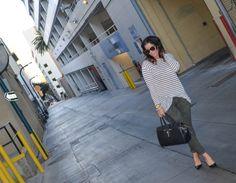 Cara's Cliche Fatigued Camo Skinnies, Striped tee, Manolo Blahnik BB