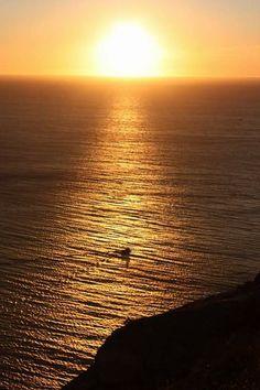 Puesta de sol en el Cabo de Finisterre, Galicia España.