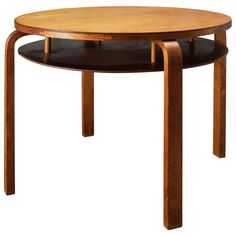 Coffee Table (1935) - Alvar Aalto>> DIMENSIONS 23.03 in.H 58.5 cmH DIAMETER 28.54 in. (72.5 cm)