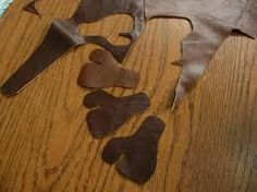 Make your own leather finger tabs and arm guards, and some good photos of quivers