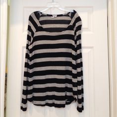Black and Silver top Beautiful black and silver striped top. Rayon and cotton. In excellent condition. Size large but brand runs small. So more like a medium. Splendid Tops