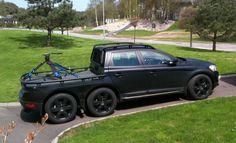 Batman's Volvo: the 6-wheel, stealth-black, XC60 pickup truck