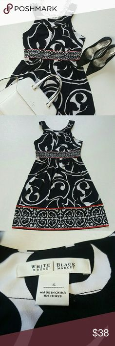 White House Black Market Dress Excellent pre owned condition Sleeveless  Black & white paisley print with red accent 95% Polyester 5% Spandex  Very stretchy White House Black Market Dresses Midi