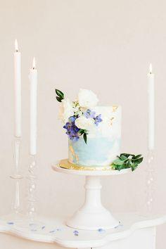 Delicate Watercolor Wedding Cake with Edible Gold Leaf | Heather Mills Photography | http://heyweddinglady.com/elegant-watercolor-wedding-shoot-bold-cobalt-blue/