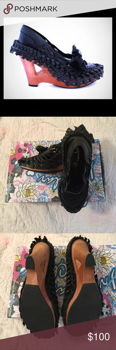 Irregular Choice Funk A Delico Wooden Wedges Irregular Choice Funk A Delico Wooden Wedges 4″ wooden cut-out wedge heel Black woven leather.  Honestly don't know that I ever wore them.  I wear an 8-8.5 so these could run small.  Comes with original Box irregular choice Shoes Wedges