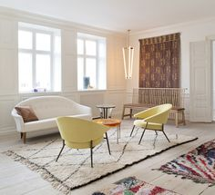 the apartment, ilse crawford sofa de la espada, michael anastassiades tube light lamp, vintage swedish sofa, beni ouarain rug, mccolillin linse table